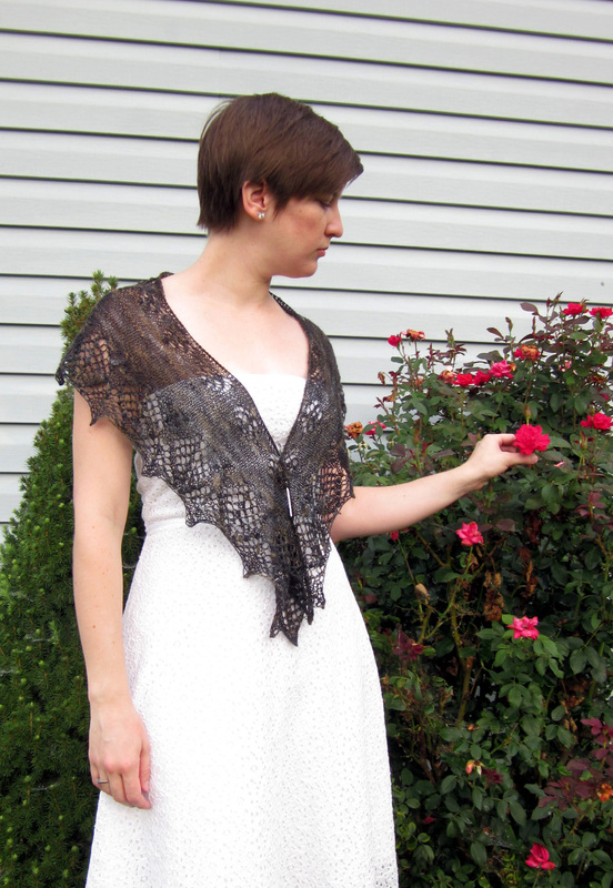 Graciella Shawl knitting pattern by Cassie Castillo.  Crescent shawl with lace and nupp border.