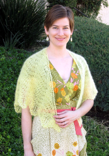 Mariposa Shawl knitting pattern by Cassie Castillo.  Feather and fan shawl with beaded lace border.