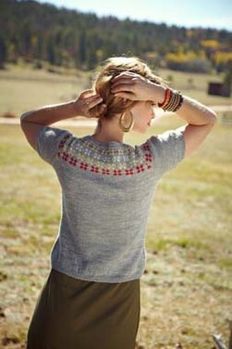 Edelweiss Cardigan knitting pattern by Cassie Castillo.  Stranded fair isle yoke sweater with flowers and short sleeves.