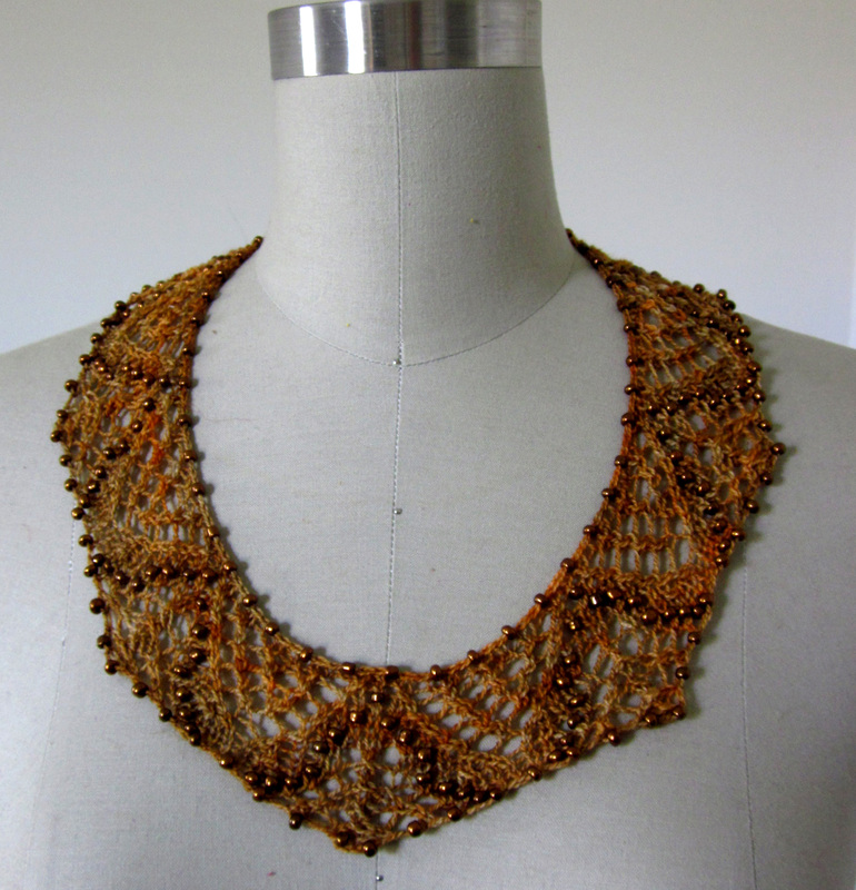 Saqqara Necklace knitting pattern by Cassie Castillo.  Beaded lace collar style necklace in two sizes.
