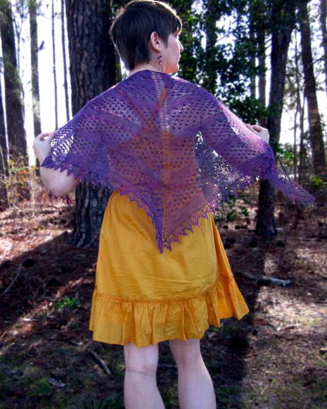 Blackberry Mist Shawl knitting pattern by Cassie Castillo.  Striped lace triangle shawl