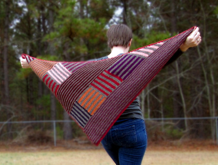 Log Cabin Shawl knitting pattern by Cassie Castillo.  Worked in striped modular sections.  Great stash buster!