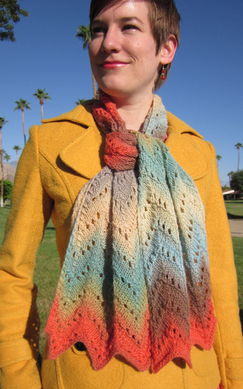 Desert Waves Scarf and Shawl knitting pattern by Cassie Castillo.  Zig zag stitch worked in a self striping yarn.