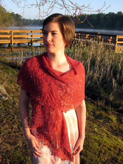 Rosana Shawl knitting pattern by Cassie Castillo.  Crescent shawl with beaded lace border.